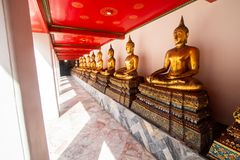 Wat Pho or Wat Phra Chetuphon buddhist temple . golden buddha statue sitting . line pattern of old historic architecture . famous. Ancient grand palace in stock photo