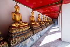 Wat Pho or Wat Phra Chetuphon buddhist temple . golden buddha statue sitting . line pattern of old historic architecture . famous. Ancient grand palace in stock photography