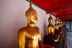 Wat Pho or Wat Phra Chetuphon buddhist temple . golden buddha statue sitting . line pattern of old historic architecture . famous. Ancient grand palace in stock image