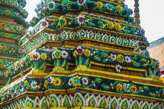 Wat Pho or Wat Phra Chetuphon,the Temple of the Reclining Buddha in Bangkok of Thailand.A fragment of decoration with flowers Stock Photos
