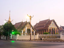 Wat Phra That Chang Kham in morning mist Stock Photo