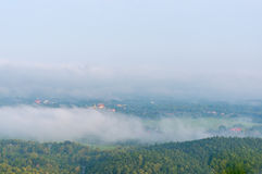 Wat Phra That Cho Hae with Fog on early morning Looking from Wat Pra That Doi Leng View Point at Phrae Province, Thailand. Royalty Free Stock Images