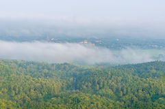 Wat Phra That Cho Hae with Fog on early morning Looking from Wat Pra That Doi Leng View Point at Phrae Province, Thailand. Stock Photography