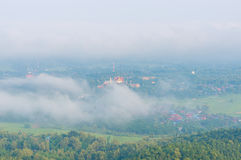 Wat Phra That Cho Hae with Fog on early morning Looking from Wat Pra That Doi Leng View Point at Phrae Province, Thailand. Stock Image