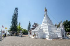 Wat Phra That Doi Kong Mu. White temple on a mountain top at Mae Hong Son northern of. Maehongson, Thailand. - February 22, 2017 : Wat Phra That Doi Kong Mu Stock Photo