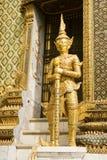 Wat Phra Kaeo Guardian. A statue of a demon guardian at the Buddhist temple of Wat Phra Kaeo at the Grand Palance in Bangkok, Thailand stock photo