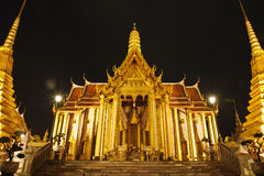 Wat Phra Kaeo at night thailand. Wat Phra Kaew, the night light with a light golden color Stock Photography