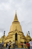 Thai temple-Wat Phra Kaew. Bangkok, Thailand - June 7, 2014: People are touring at Wat Phra Kaew, Bangkok, Thailand Stock Image