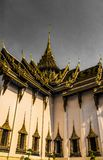 Wat Phra Kaew, commonly known in English as the Temple of the Emerald Buddha or grand palace is regarded as most sacred Buddhist royalty free stock photo