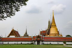 Wat Phra Kaew, commonly known in English as the Temple of the Emerald Buddha or grand palace is regarded as the most sacred Buddhi stock photo
