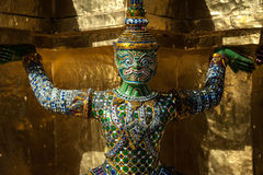 Wat Phra Kaew. The Demon Statue Supporting Golden Pagoda on Grand Palace, Temple of the Emerald Buddha Wat Phra Kaew, Bangkok, Thailand stock images