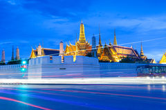 Wat Phra Kaew (Temple of Emerald Buddha) and Grand Palace at dusk. Traffic near Wat Phra Kaew (Temple of Emerald Buddha) and Grand Palace, Bangkok, Thailand stock photos