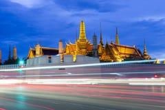 Wat Phra Kaew (Temple of Emerald Buddha) and Grand Palace at night. Traffic near Wat Phra Kaew (Temple of Emerald Buddha) and Grand Palace, Bangkok, Thailand Stock Photos