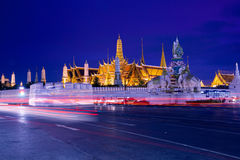 Wat Phra Kaew (Temple of Emerald Buddha) and Grand. Traffic near Wat Phra Kaew (Temple of Emerald Buddha) and Grand Palace, Bangkok, Thailand Stock Photo