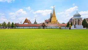 Wat Phra Keaw. Entrance of Wat Phra Kaew with green field Royalty Free Stock Photos