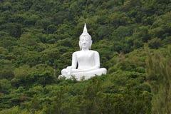 White buddha statue on the mountain Stock Photo