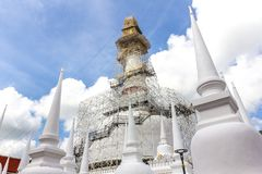 Wat Phra Mahathat Woramahawihan, the 8 walking Buddhas on top of. The Stupa Stock Photo
