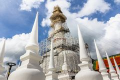 Wat Phra Mahathat Woramahawihan, the 8 walking Buddhas on top of. The Stupa Stock Image