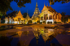 Wat Phra Sing with the water reflection after rainning, Chiang Mai, Thailand. Royalty Free Stock Images