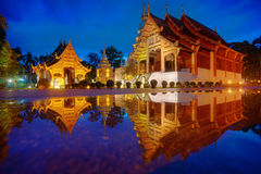 Wat Phra Sing with the water reflection after rainning, Chiang Mai, Thailand. Stock Images