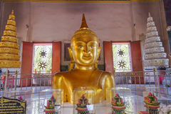 A golden Buddha image interred up to the cheat in Wat Phra Thong Royalty Free Stock Images