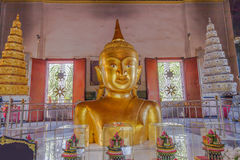 A golden Buddha image interred up to the cheat in Wat Phra Thong Stock Photography