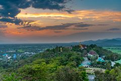 Wat Phrathat Doi Saket with the sunset sky and clouds. Wat Phrathat Doi Saket with the sunset sky and clouds in the background. Chiang Mai, Thailand Royalty Free Stock Images