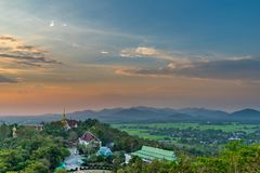 Wat Phrathat Doi Saket with the sunset sky and clouds. Wat Phrathat Doi Saket with the sunset sky and clouds in the background. Chiang Mai, Thailand Royalty Free Stock Photos