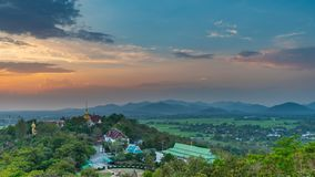 Wat Phrathat Doi Saket with the sunset sky and clouds. Wat Phrathat Doi Saket with the sunset sky and clouds in the background. Chiang Mai, Thailand Stock Photos