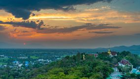 Wat Phrathat Doi Saket with the sunset sky and clouds. Wat Phrathat Doi Saket with the sunset sky and clouds in the background. Chiang Mai, Thailand Stock Photography