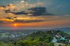 Wat Phrathat Doi Saket with the sunset sky and clouds. Wat Phrathat Doi Saket with the sunset sky and clouds in the background. Chiang Mai, Thailand Stock Photo