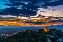 Wat Phrathat Doi Saket with the sunset sky and colorful cloud. Wat Phrathat Doi Saket with the sunset sky and colorful scattered clouds in the background. Chiang Stock Photos