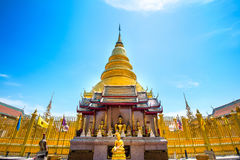 Wat Phrathat Hariphunchai Golden pagoda. Stock Photography