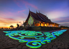 Wat Phuproud magical glow at sunset. The only place in the world in Thailand Stock Image