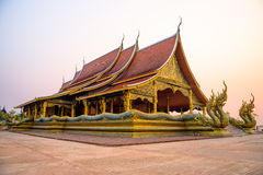 Wat phuproud. Temple in the sunset from thailand Stock Photos
