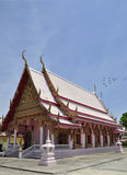 Pink BUddhist temple, blue sky, Thailand Royalty Free Stock Photo