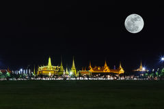 Wat pra kaew Public Temple Grand palace with super moon at night, Bangkok Thailand Stock Photos