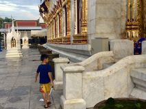 A boy in Wat , Bangkok royalty free stock image