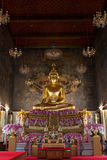 Wat Ratchanaddaram Buddha. Statue of Buddha in the Radnudda temple church with rarely special decoration with purple flowers for  Queen Sirikit welcome Stock Photography