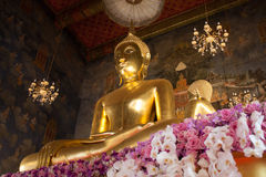 Wat Ratchanaddaram Buddha. Statue of Buddha in the Radnudda temple church with rarely special decoration with purple flowers for  Queen Sirikit welcome Stock Image