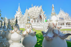 Wat Rong Khun temple in Chiangrai, Thailand. Beautiful ornate white temple in Chiang Rai northern Thailand Stock Photos