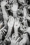 Sculpture of beggar hands collect metal coin money, Chiangrai Th