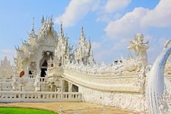 Wat Rong Khun White Temple, Chiang Rai, Thailand. Wat Rong Khun perhaps better known to foreigners as the White Temple, is a contemporary, unconventional stock photo