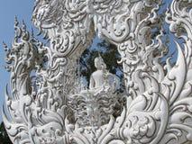 Wat Rong Khun - White Temple Chiang Rai view. Wat Rong Khun, the White Temple view of Buddha sculpture and ornamentation Royalty Free Stock Photo