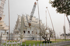 Wat Rong Khun or White Temple, a contemporary unco. Nventional Buddhist temple in Chiangrai, Thailand, with white Lanna style flags Stock Photography