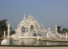Wat Rong Khun or White Temple, a contemporary unco. Nventional Buddhist temple in Chiangrai, Thailand, was designed by Arjan Chalermchai Kositpipat Stock Photos