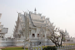 Wat Rong Khun or White Temple, a contemporary unco. Nventional Buddhist temple in Chiangrai, Thailand, was designed by Arjan Chalermchai Kositpipat Stock Image