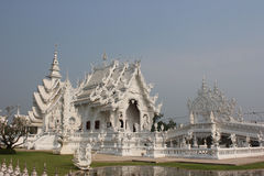 Wat Rong Khun or White Temple, a contemporary unconventional Bud. Dhist temple in Chiangrai, Thailand, was designed by Arjan Chalermchai Kositpipat Stock Image