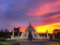 Wat Rong Khun (The White Temple) under amazed sky Stock Photos