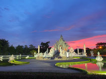 Wat Rong Khun (The White Temple) under amazed sky Royalty Free Stock Images